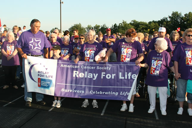 Crowd holding relay for life sign