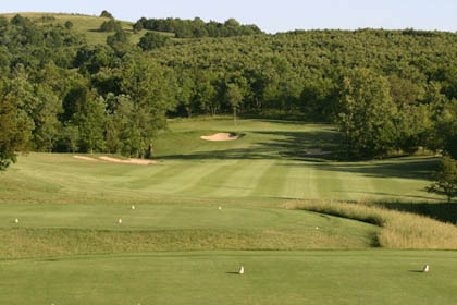 View from the tee down the fairway of the 354 yard par 4 sixth hole of the Branson Creek Golf Course.